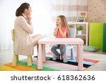 young woman teacher and little... | Shutterstock . vector #618362636