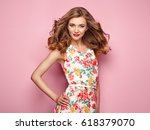 blonde young woman in floral... | Shutterstock . vector #618379070