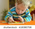 little toddler doing puzzle.... | Shutterstock . vector #618380708