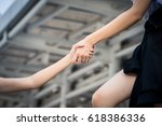 woman pull up someone to get up. | Shutterstock . vector #618386336