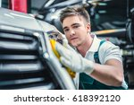 young man with car | Shutterstock . vector #618392120
