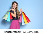 Woman With Shopping Bags On...