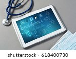 white tablet pc and doctor... | Shutterstock . vector #618400730