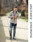 fashionable man walking on the... | Shutterstock . vector #618411569