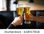 men cheers with beer in glasses ... | Shutterstock . vector #618417818