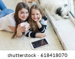 girls with a tablet  | Shutterstock . vector #618418070