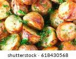 Small photo of The toasted baked potato strewed with herbs. Fried crust, close up, selective focus