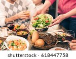 nice family having tasty dinner | Shutterstock . vector #618447758