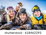 group of friends with ski on... | Shutterstock . vector #618462293