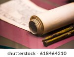 an ancient scroll on the table... | Shutterstock . vector #618464210