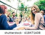group of friends at restaurant... | Shutterstock . vector #618471608