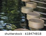 Traditional Ladles On Fountain...