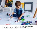 cute  happy  white boy in blue... | Shutterstock . vector #618489878