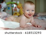 a little boy  a baby with blue... | Shutterstock . vector #618513293