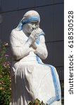 Small photo of TIRANA, ALBANIA - SEPTEMBER 27: Mother Teresa statue in front St Paul's Cathedral in Tirana, Albania on September 27, 2016.