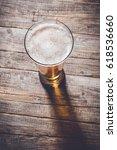 glass of beer. top view | Shutterstock . vector #618536660