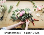 florist at work  pretty young... | Shutterstock . vector #618542426