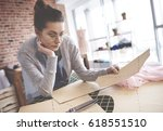 thoughtful mid adult tailor  | Shutterstock . vector #618551510