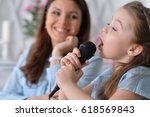 Mom And Daughter Sing