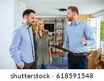 Small photo of Photo of a young couple counseling with financial adviser at home.