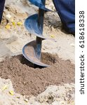 Small photo of Boer who bore the ground. Drilling rig boring hole in soil at construction site