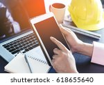 engineer holding a blank tablet ... | Shutterstock . vector #618655640
