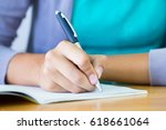 close up of writing hands of... | Shutterstock . vector #618661064