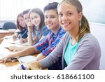 group of students sitting in... | Shutterstock . vector #618661100