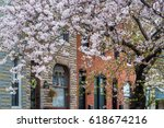 cherry blossoms and row houses... | Shutterstock . vector #618674216