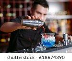 bartender pouring fresh... | Shutterstock . vector #618674390