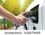 electric vehicle charging... | Shutterstock . vector #618674669