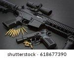 handgun with rifle over dark... | Shutterstock . vector #618677390