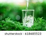 the glass of cool fresh water... | Shutterstock . vector #618685523