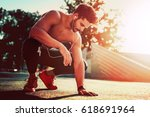 young male jogger athlete... | Shutterstock . vector #618691964