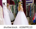 female trying on wedding dress... | Shutterstock . vector #618699113