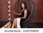 beautiful girl in black evening ...   Shutterstock . vector #618743840