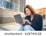 enthusiastic woman working... | Shutterstock . vector #618744128
