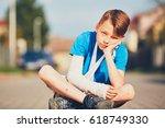mischievous boy with broken... | Shutterstock . vector #618749330
