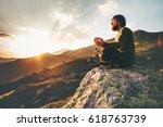 man meditating yoga lotus pose...   Shutterstock . vector #618763739