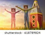 children in astronauts costumes ... | Shutterstock . vector #618789824