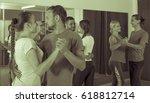 positive adult people dancing... | Shutterstock . vector #618812714