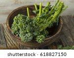 raw green organic broccolini... | Shutterstock . vector #618827150