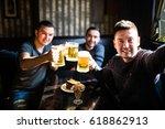three young men in casual... | Shutterstock . vector #618862913