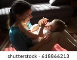 mother playing with her baby... | Shutterstock . vector #618866213