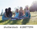group of girls sitting together ... | Shutterstock . vector #618877394