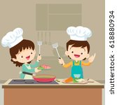 cute boy and girl cooking in... | Shutterstock .eps vector #618880934