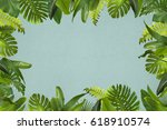 tropical leaves background | Shutterstock . vector #618910574