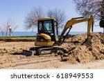Small Excavator Digging Sand