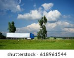 blue truck driving on the road... | Shutterstock . vector #618961544
