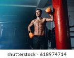 male boxer training in dark gym....   Shutterstock . vector #618974714